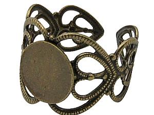 Основа для кольца ажурная с круглой платформой .  Диаметр платформы 10 мм.  Размер кольца регулируется.