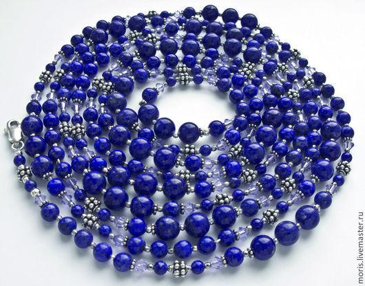 Длинные бусы (209 см) синего цвета, из разных по размеру бусин из натурального лазурита природного цвета, маленьких  бусинок граненого гематита и бусин ручной работы из серебра.