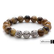 Bead bracelet handmade. Livemaster - original item Men`s bracelet made of Baltic amber with silver charms. Handmade.