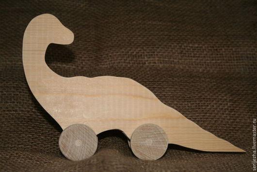 Динозавр-каталка, деревянная игрушка ручной работы