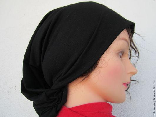 шапка-чулок из черного трикотажа, состав: хлопок, вискоза, эл . Длина 40-50 см.