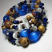 Bead bracelet handmade. Livemaster - original item Bracelet with lapis lazuli and koshachii eye