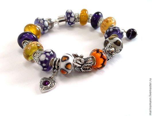 Фиолетово-золотые драконы. Стоимость браслета 1550 руб.