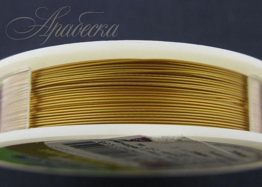 Тросик ювелирный  матового золотого цвета 0.47мм BEADALON (США) 0.5м