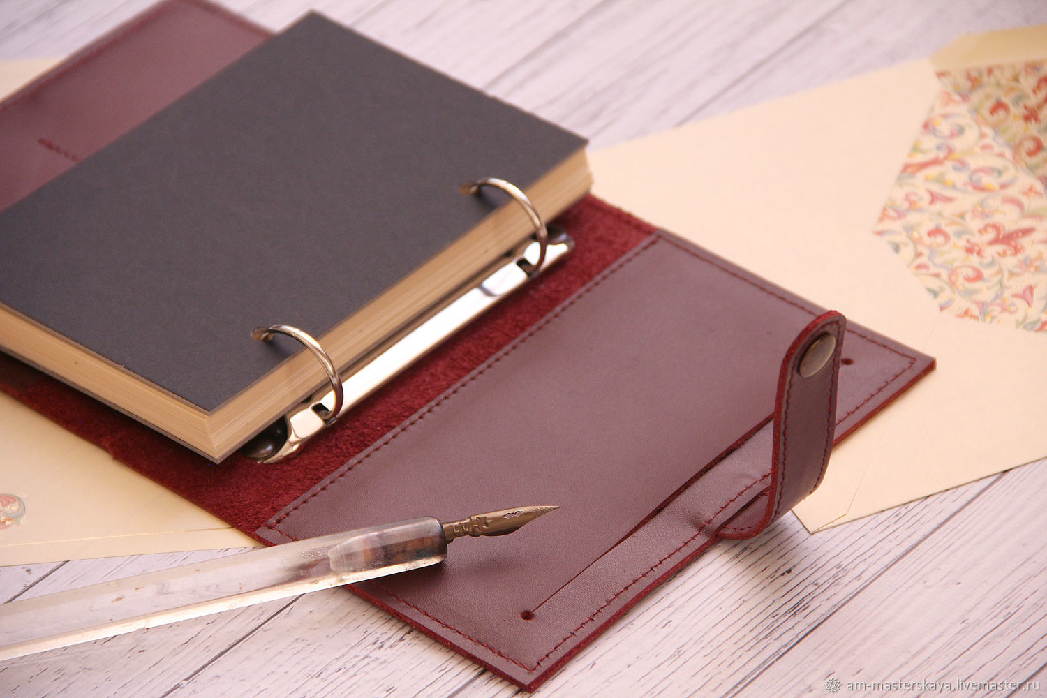 Notebook leather A6 on the rings
