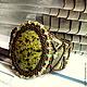 Браслет вышитый бисером ,,Летняя зелень,, Браслет вышит японским бисером по коже, по центру крупный красивейший камень змеевик. Мастер Натэлла Шемякина.