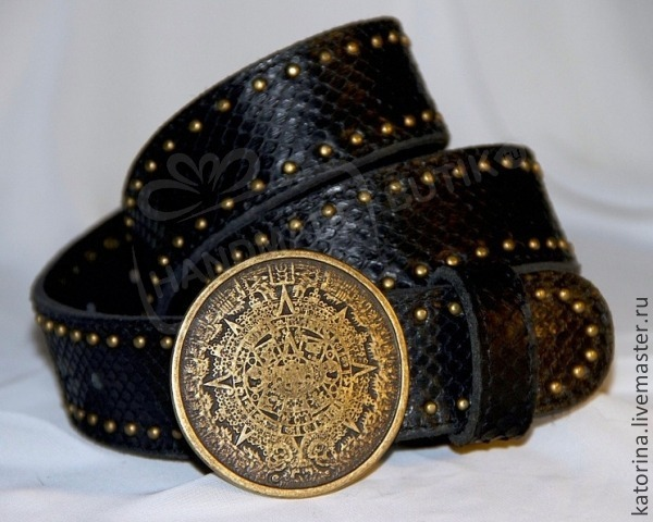 Belt made from Python leather the Mayan Calendar. The buckle is made from brass in the style of the Mayan calendar.