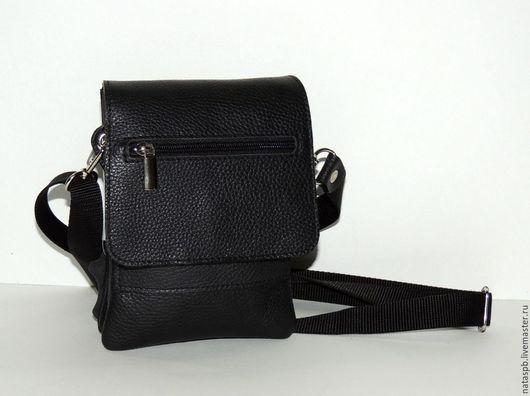 Сумка «Тайм» - небольшая сумка для документов и нужных мелочей. Изготовлена из мягкой черной кожи.