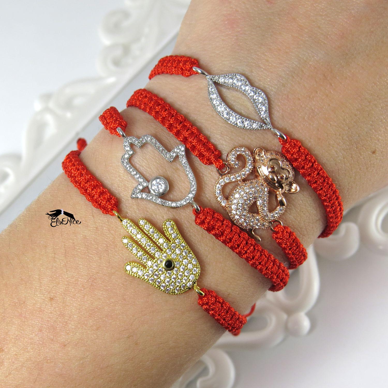 Что означает плетеный браслет на руке