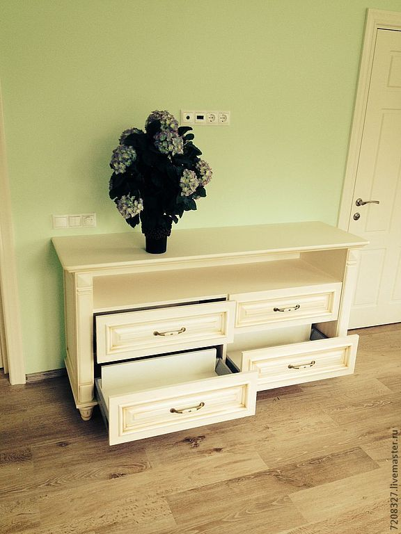 A classic dresser made of wood. Functional and stylish - has enough space for storage. Stylish timeless chest of drawers is an elegant addition to the bedroom or living room.