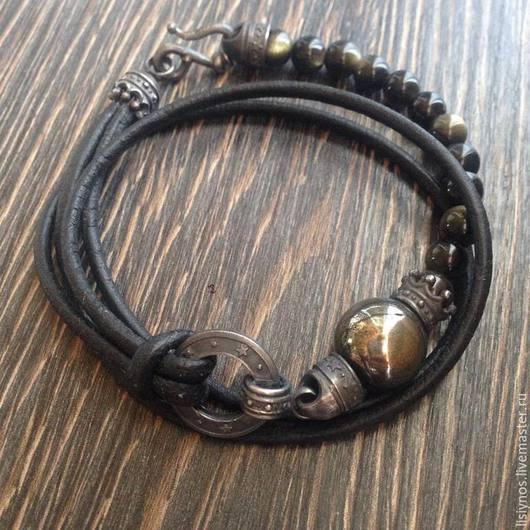 Браслет авторского дизайна. Кожаный шнур,чернёное серебро ,центральная бусина пирита,бусины солнечного обсидиана .Удачное совмещение кожи,серебра и камней в одном браслете.