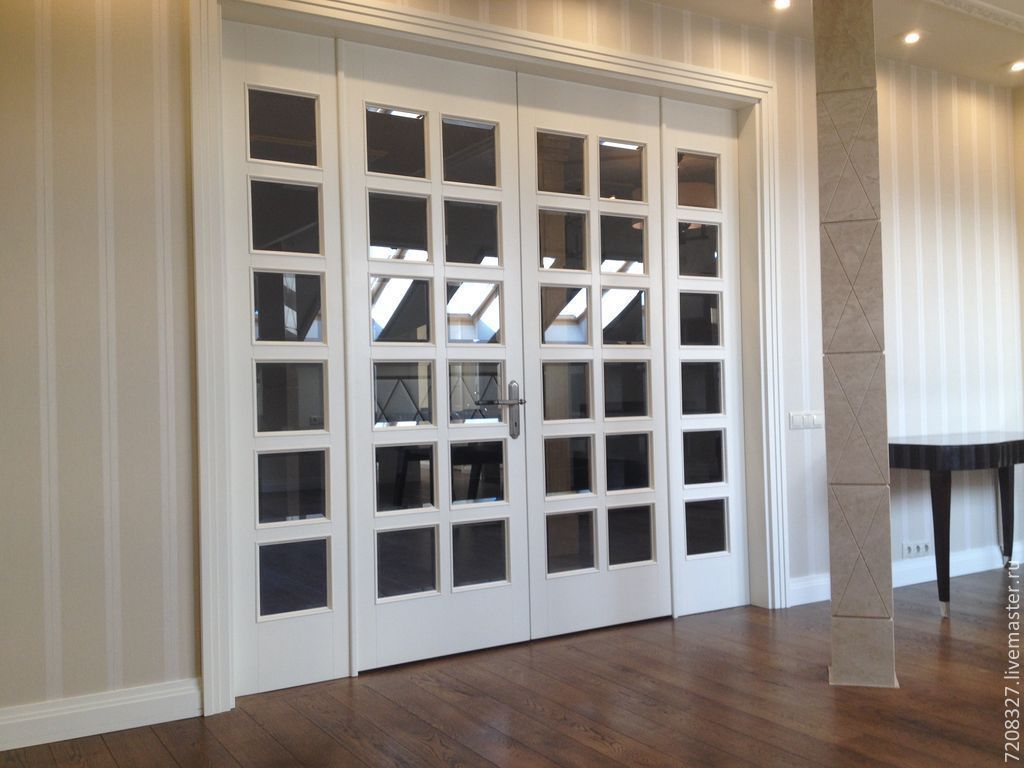 beautiful large hinged doors. made in the classic style. 36 square glass cut lend to its elegance and brevity. majestically elegant trim complement the ensemble.