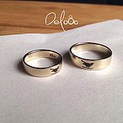 Обручальные кольца с гравировкой из золота