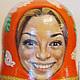 Матрешка высотой 20 см, лица - шаржи. 2013. Германия. Фрагмент росписи.