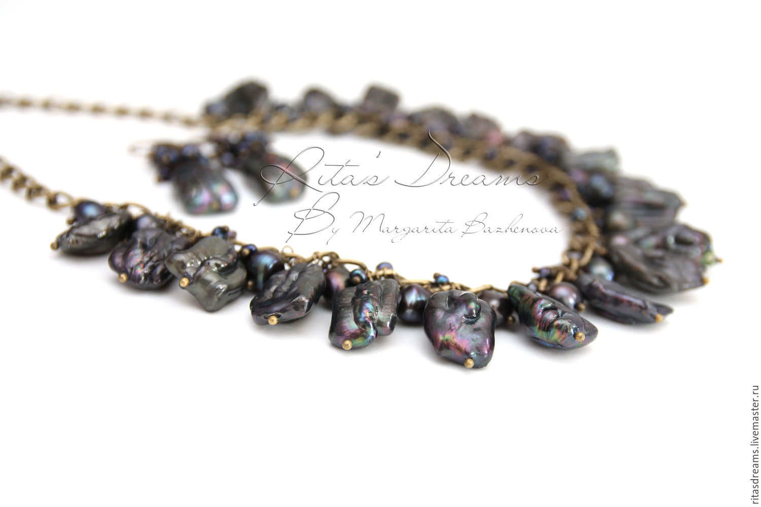 Necklace and earrings of fine pearls of various forms of black color with beautiful pearlescent purple tint.