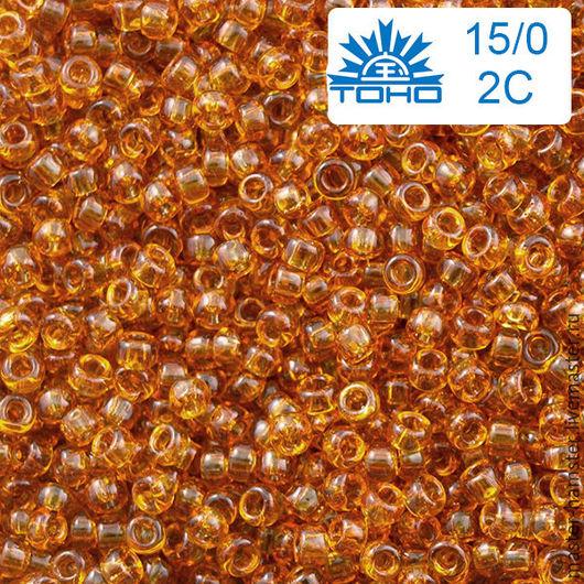 Японский бисер TOHO 15/0-2С 5 гр янтарный прозрачный