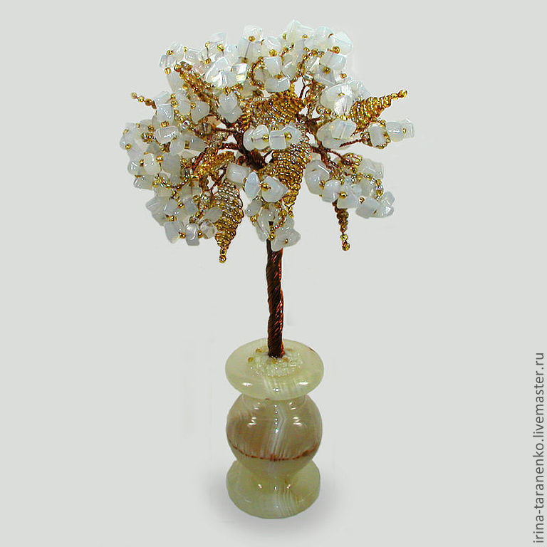 Tree of happiness from a moonstone in a vase of onyx