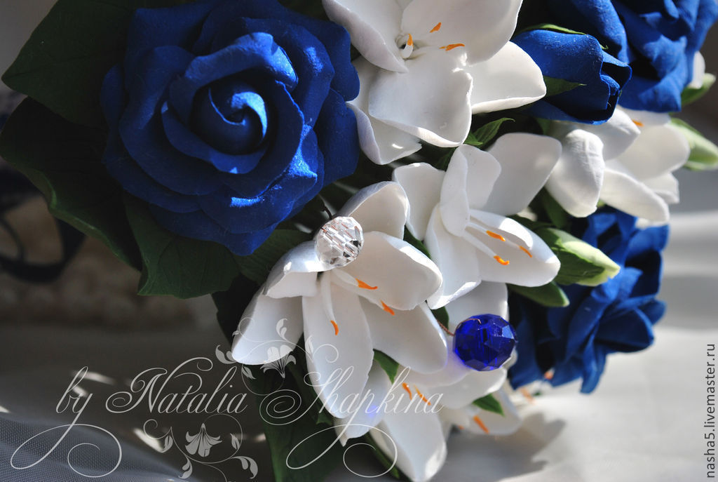 Wedding bouquet of blue roses and freesia with the addition of crystal ... 792bcd1d6c2