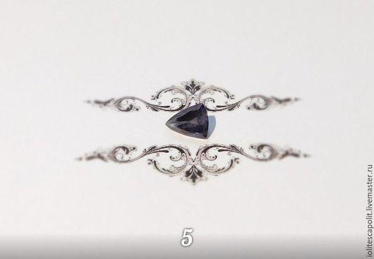 Размер: 9,5х7,2 Вес: 1,50 Иолит. Огранка Триллиант. Происхождение: Памир. Цена: 2000 руб
