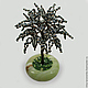 Изделие из гематита `Осирис` в вазочке из оникса