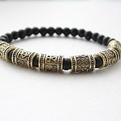 Украшения handmade. Livemaster - original item A bracelet made of beads with a bronze palaces. Handmade.