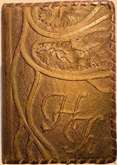 Буквы делаются рельефом вручную, рельефом под кожей.