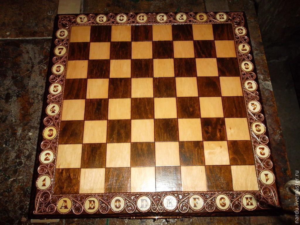 Резные шахматы ручной работы фото