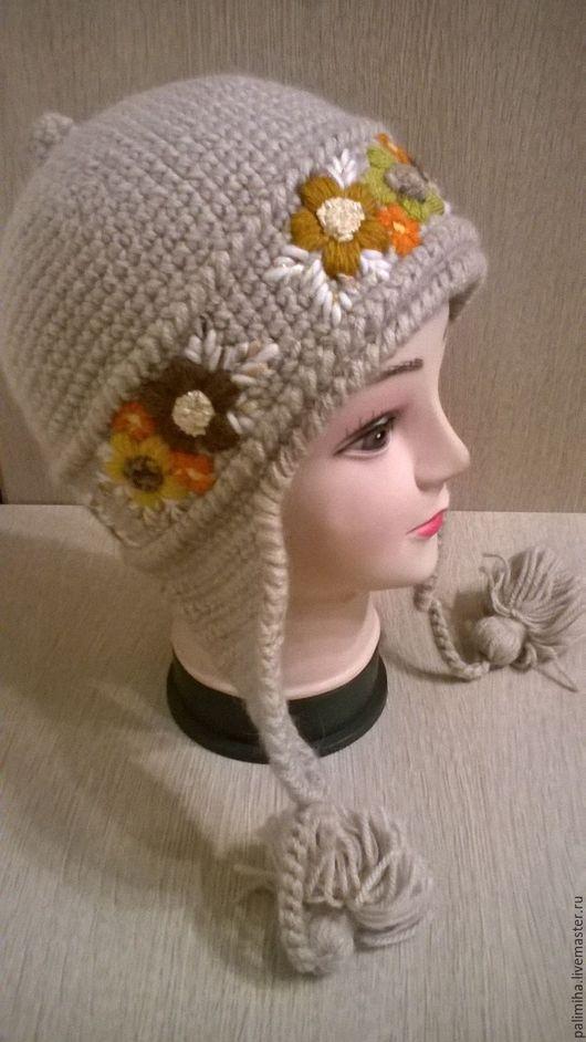 Зимняя тёплая шапка-шлем с ручной вышивкой, ручной работы. Выполнена крючком из махеровой и акриловой нити. Оригинальная, стильная, яркая, никого не оставит равнодушным.