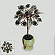 Miniature tree of happiness from shungite in a vase of onyx