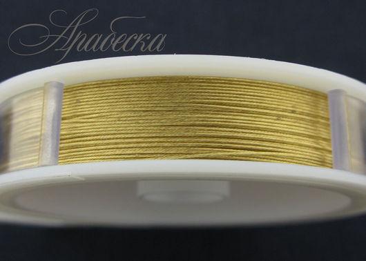 Тросик ювелирный  золотого цвета 0.47мм BEADALON (США) 0.5м