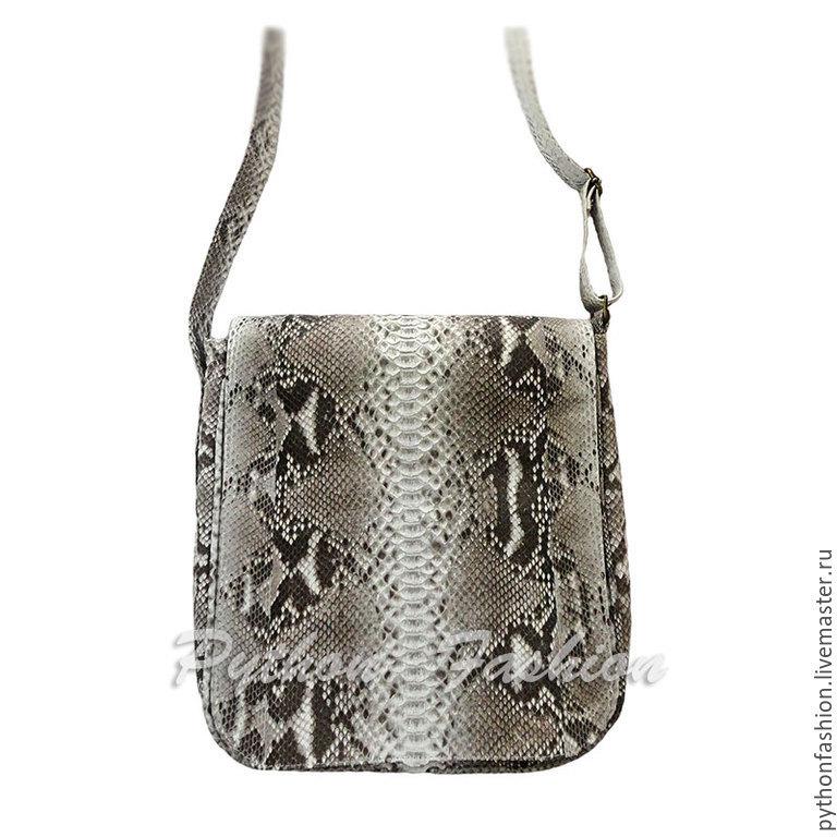 Handbag made of Python skin. The author's men's bag made of Python strap. Mens bag for documents. Men's bag made from Python for details. Comfortable men's bag made of Python over the shoulder