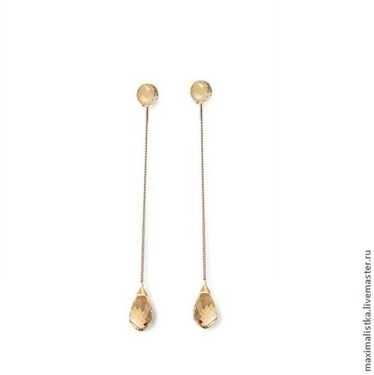 Золотые серьги с цитринами на цепочке.