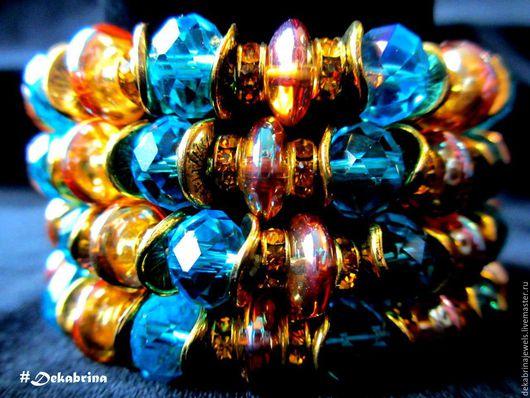 Материалы: бусины #стекло 10мм в 2х огранках, с эффектом мраморирования и гальваническим напылением, #фурнитура под #золото, оранжевые #стразы, двойная эластичная основа.