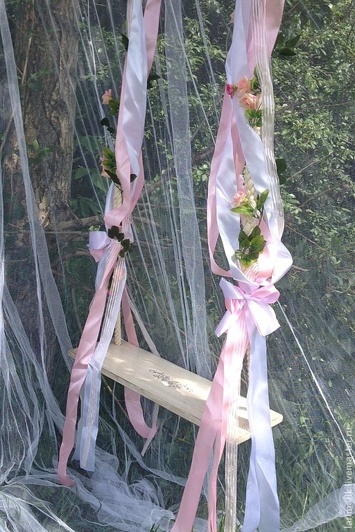 Swing with a garland of artificial flowers, adorned with ribbons of organza and satin. Variant - tied bows.