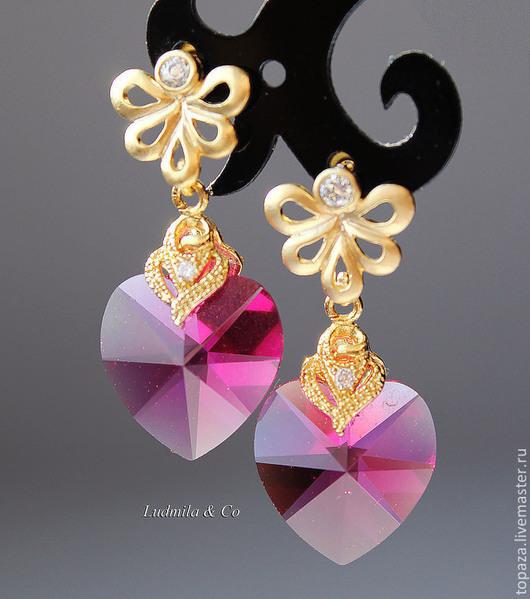 Позолоченные серьги гвоздики с кристаллами Сваровски очень красивого малинового цвета.
