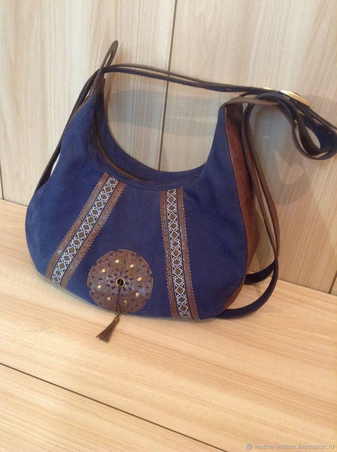 Leather women's bag in boho style with decor on two long straps of blue / brown soft shape volume comfortable on the lock with pockets. Decor-braid, leather, mandala, rivets, brush