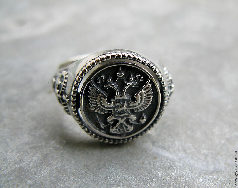 серебренные кольца со знаком порша мусшкие