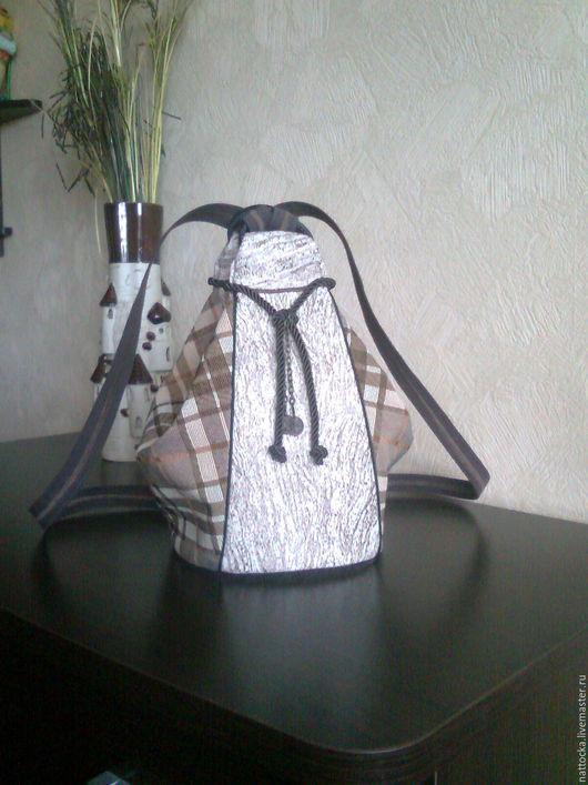 В сложенном виде получается рюкзачок.