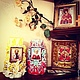 Фото заказчиков, две резные свечи-подсвечника с иконами мужа и жены: святые Галина и Василий.