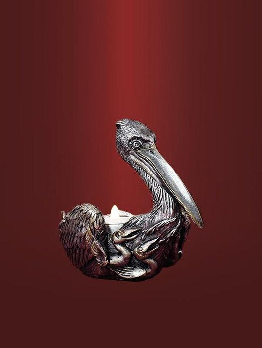 Пеликан - символ жертвенной любви. Подсвечник под круглую свечу, в  чернении