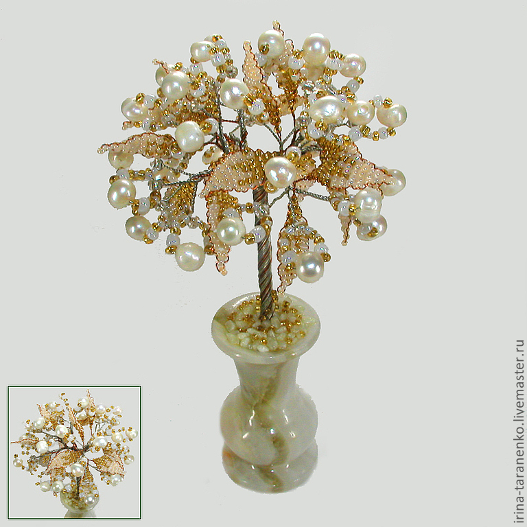 Tree of happiness from a white pearl in the vase of onyx