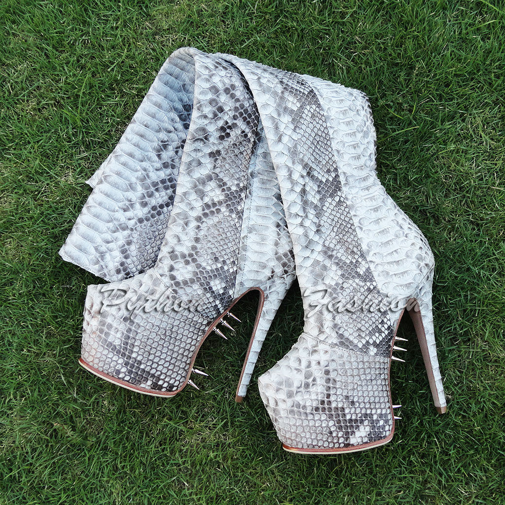 Shoes from Python. Soft designer boots from Python zip. The author's female handmade shoes on the platform. Economie boots heels. Fashion boots made from Python custom.