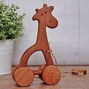 Rolling Toys handmade. Livemaster - original item Wooden toy-gurney Giraffe. Handmade.