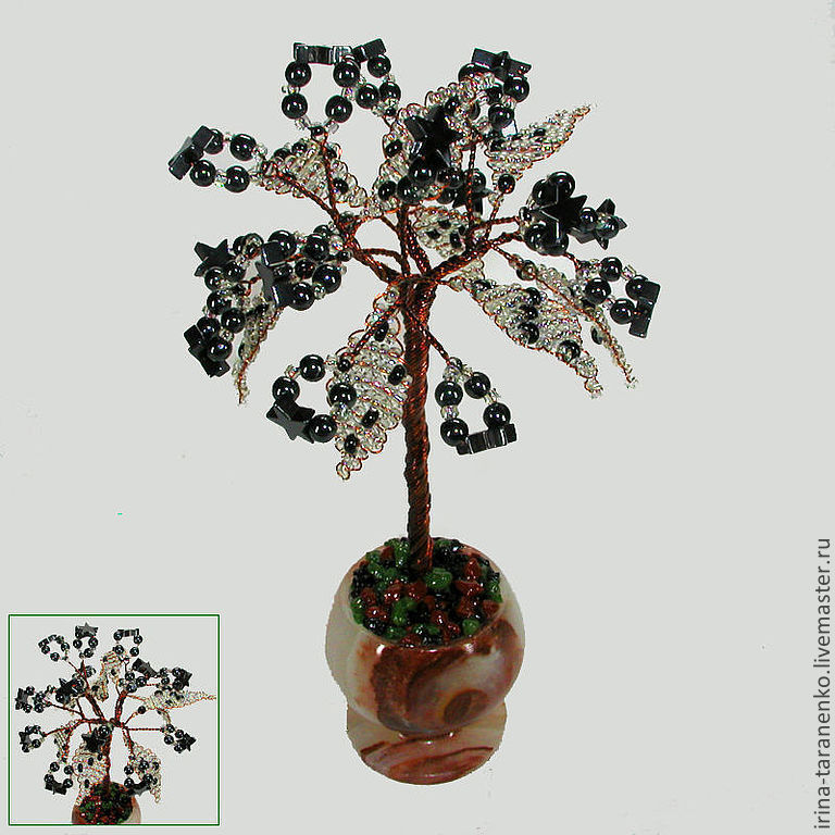 A miniature tree of happiness from hematite in a vase of onyx