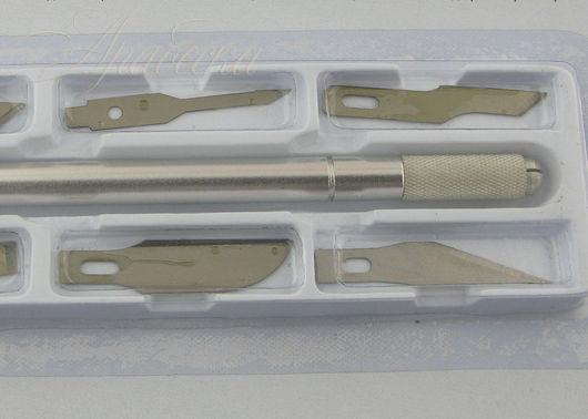 Нож для художественных работ со сменными лезвиями Mr.Painter (Китай)