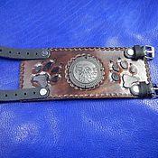 Украшения handmade. Livemaster - original item Wide leather bracelet with embossed buckle Wolf. Handmade.