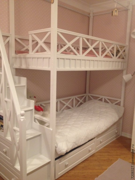 Graceful white bunk bed with spacious beds, ergonomic staircase, comfortable and practical storage system will be a truly favorite piece of furniture in the nursery.