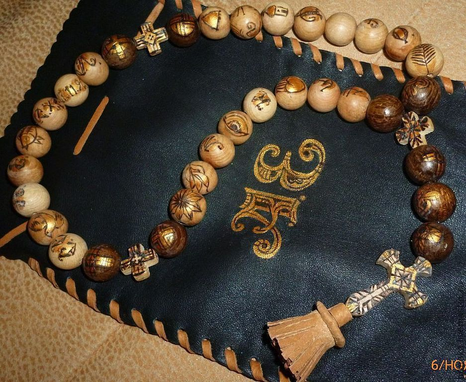 Classic Orthodox rosary of juniper beads with burnt canonical symbols and letter names
