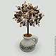 Tree from the tiger eyes vase made of white clay