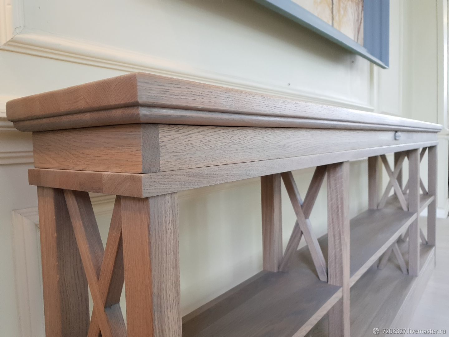 Oak console table with open shelves and a decorative crisscross elements. He will perfectly fit into any modern interior, noting the presence the nature of his repeatable texture .